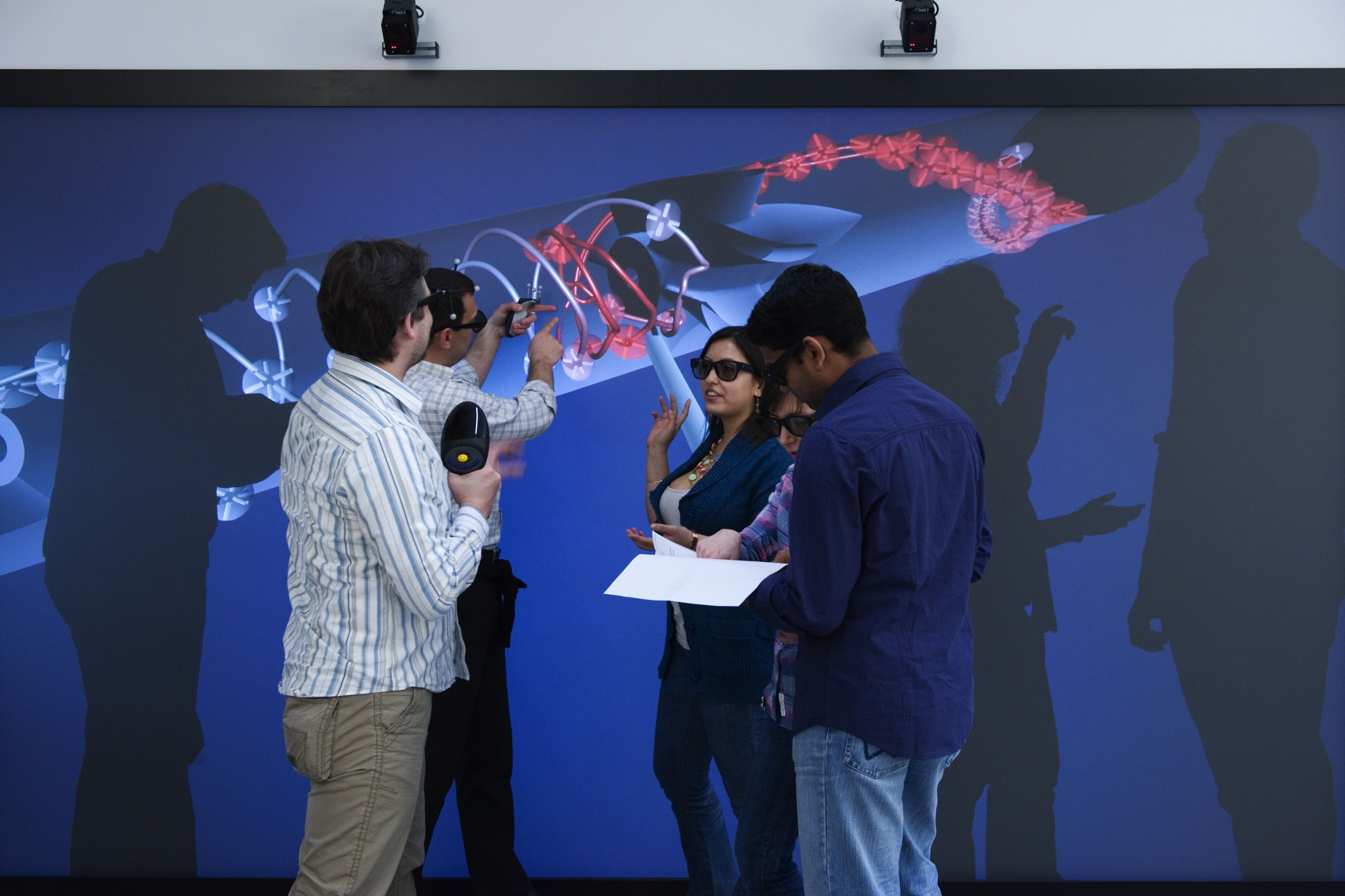 Cover picture of the profile area brochure with scientists in front of a projection screen